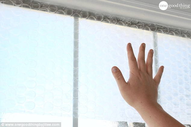 Then press the flat side of the bubble wrap up against the window with your hand